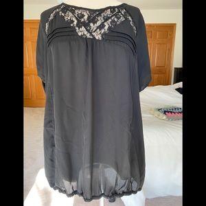 Intricate black blouse.